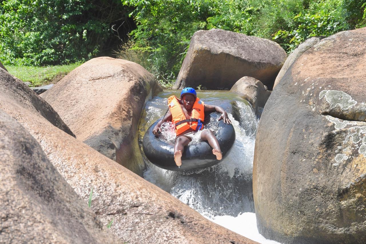 Green Corridors guide Joe Jiyane tubing the rapids. Photo courtesy of Hilary McLernan